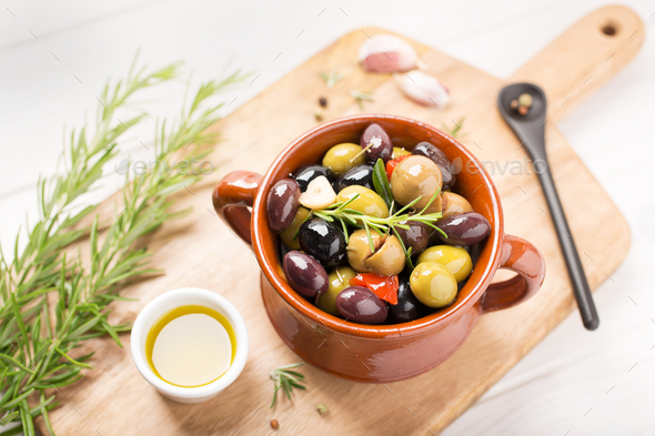 Marinated olives in bowl - Stock Photo - Images