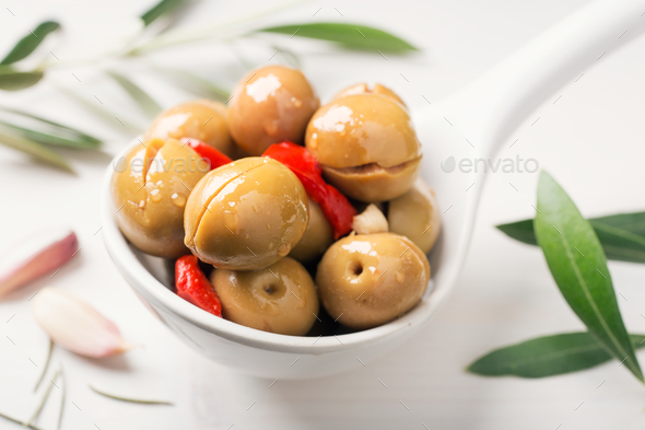 Spiced olives in spoon - Stock Photo - Images