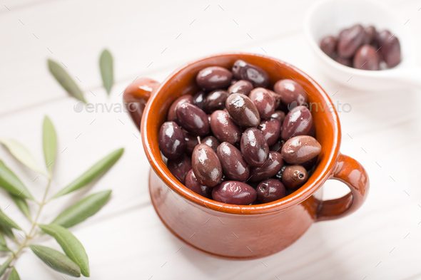 Aragon olives on rustic bowl - Stock Photo - Images