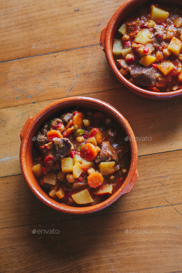 potatoes and meat stew on a clay container - Stock Photo - Images