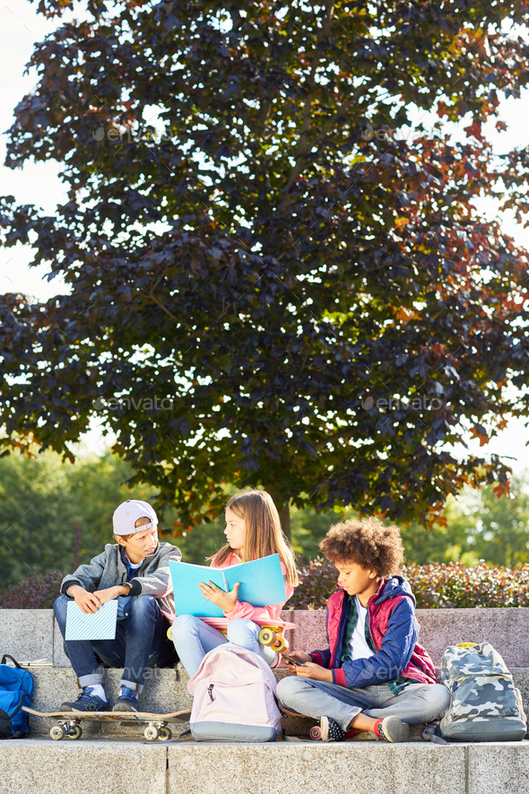 Children spending time outdoors - Stock Photo - Images