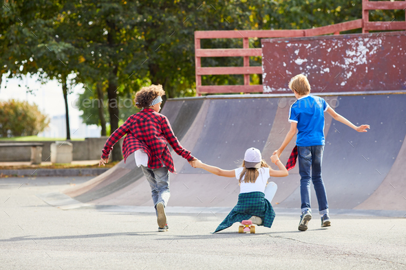 Children having fun in the park - Stock Photo - Images