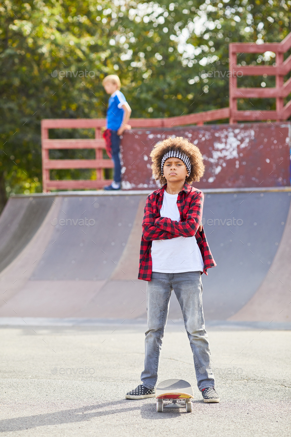 African boy with skateboard - Stock Photo - Images