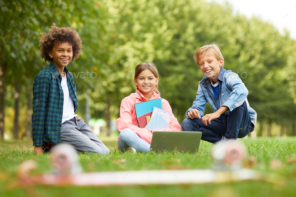 Group of friends sitting outdoors - Stock Photo - Images