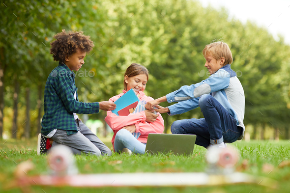 Children having fun outdoors - Stock Photo - Images
