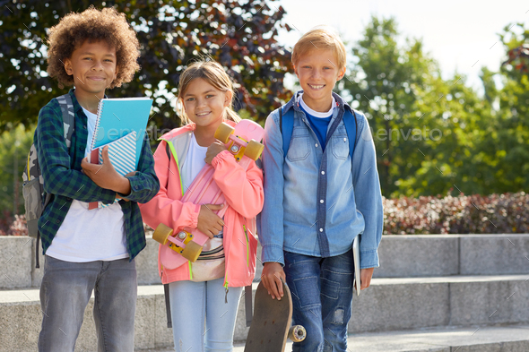 Happy children standing outdoors - Stock Photo - Images
