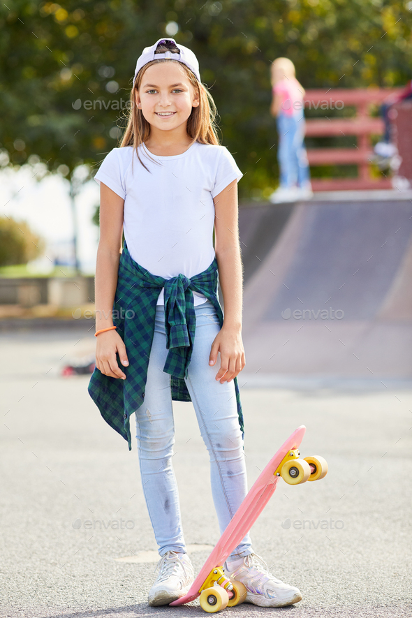 Girl with skateboard outdoors - Stock Photo - Images