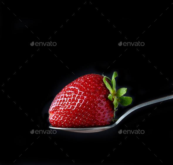 fresh ripe strawberry on black background - Stock Photo - Images