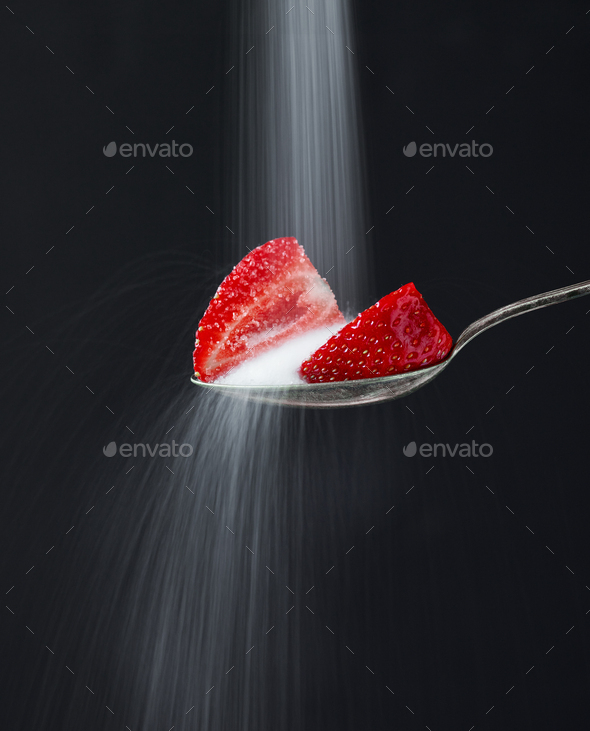 spoon of strawberry pieces - Stock Photo - Images