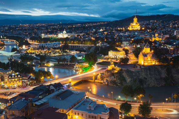 Tbilisi, Georgia. Evening Night View Of Georgian Capital Skyline. Scenic Top View Of Summer Evening - Stock Photo - Images