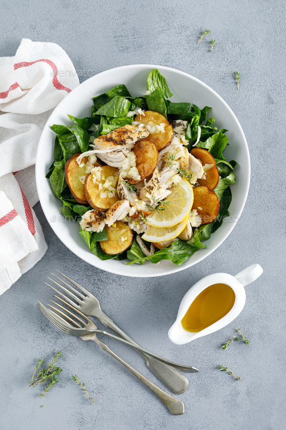 Chicken salad with spinach and crispy potatoes - Stock Photo - Images