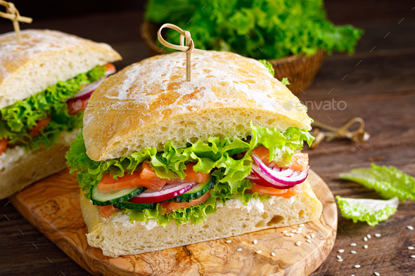 Sandwiches with homemade ciabatta bread, salted salmon - Stock Photo - Images