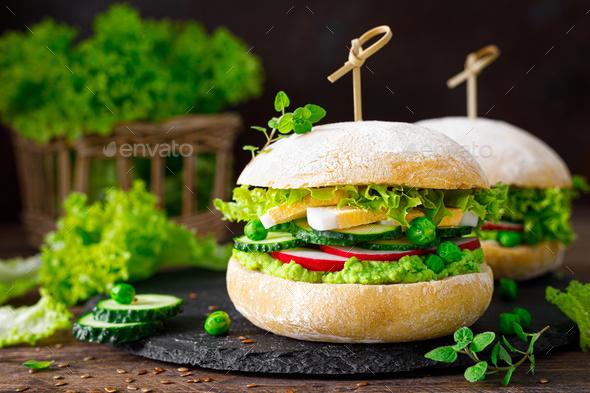 Hamburger with homemade ciabatta bun bread, boiled egg - Stock Photo - Images