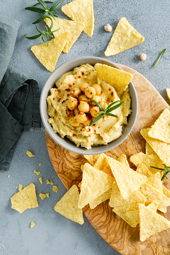 Homemade chickpea hummus with chips - Stock Photo - Images