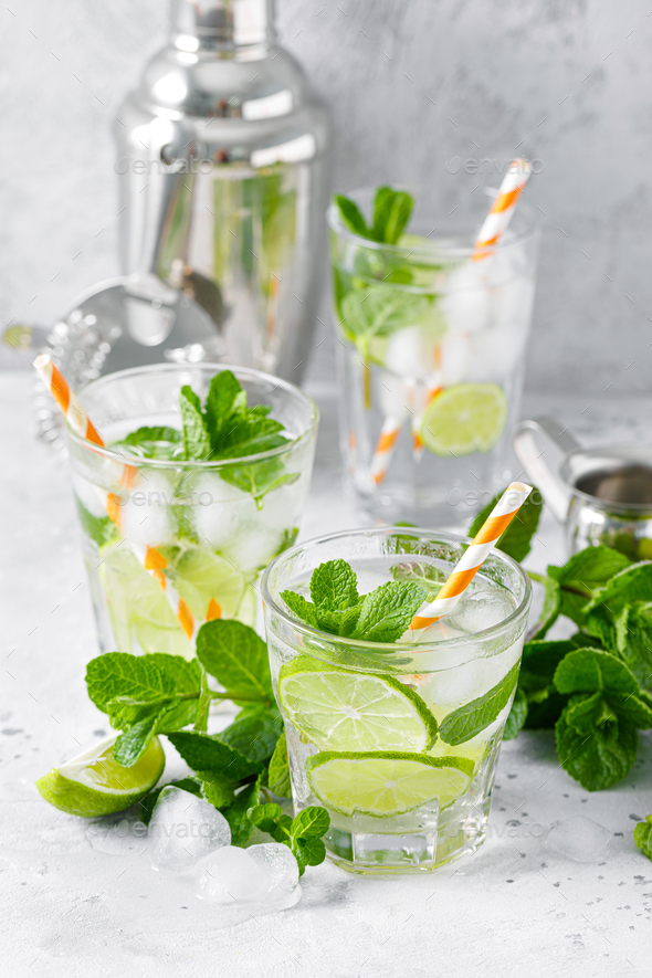 Refreshing summer alcoholic cocktail mojito with ice, fresh mint and lime - Stock Photo - Images
