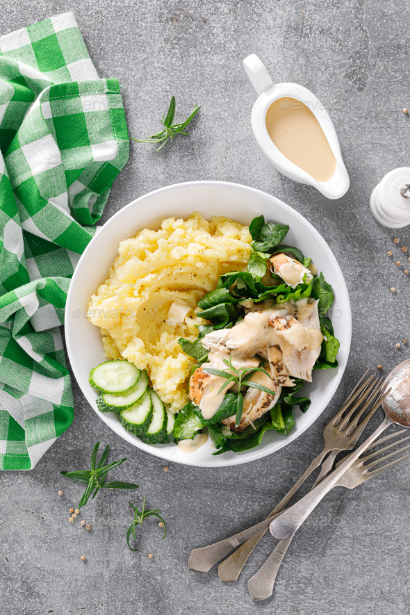 Mashed potato with grilled chicken and spinach salad - Stock Photo - Images