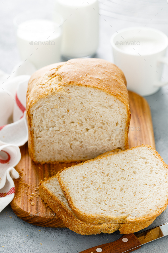 Homemade white wholegrain bread sliced on wooden board - Stock Photo - Images