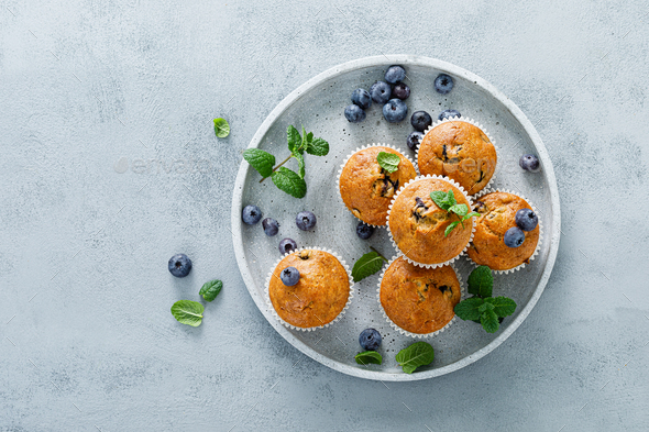 Blueberry banana muffins with fresh berries - Stock Photo - Images