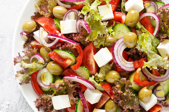 Greek salad with fresh vegetables, lettuce and feta cheese - Stock Photo - Images