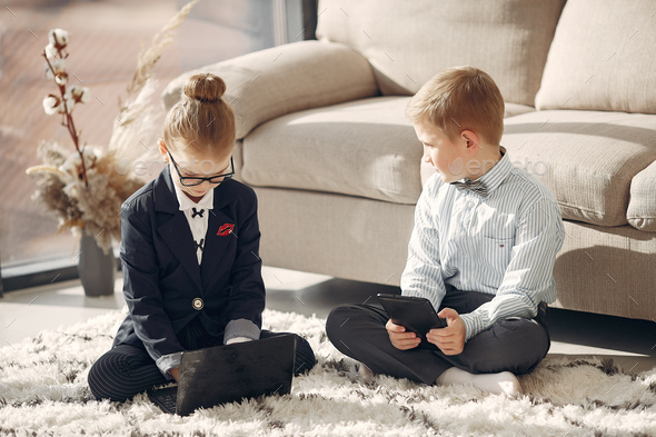 Children at the office with a laptop - Stock Photo - Images