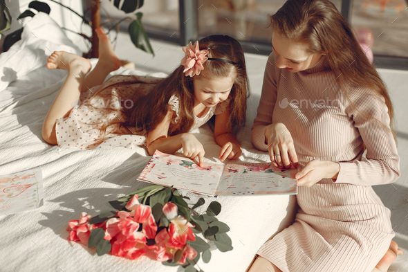 Children gave flowers to mom for mother's day - Stock Photo - Images
