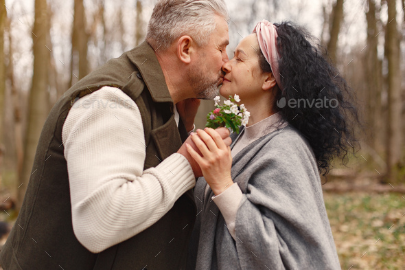 Elegant adult couple in a spring forest - Stock Photo - Images