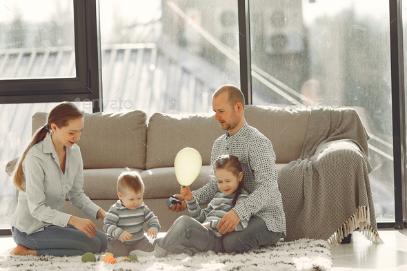Beautiful family spend time in a bedroom - Stock Photo - Images