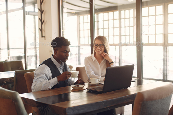 Stylish people working in a office and use the laptop - Stock Photo - Images