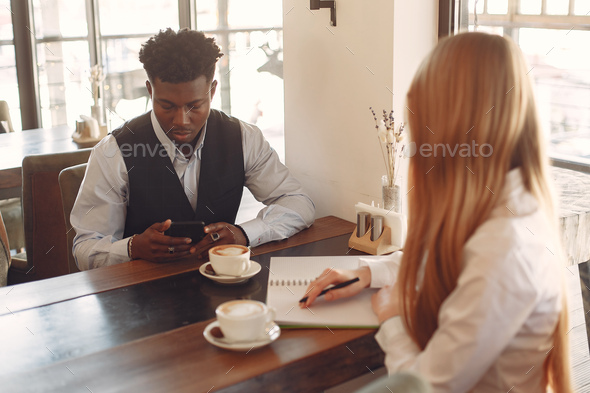 Stylish people working in a office and use the phone - Stock Photo - Images