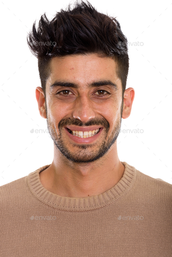 Face of young happy Persian man smiling - Stock Photo - Images