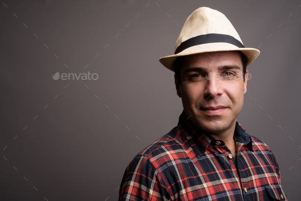 Handsome Persian tourist man ready for vacation against gray bac - Stock Photo - Images