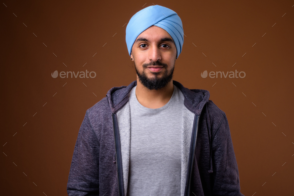 Young bearded Indian Sikh man wearing turban - Stock Photo - Images