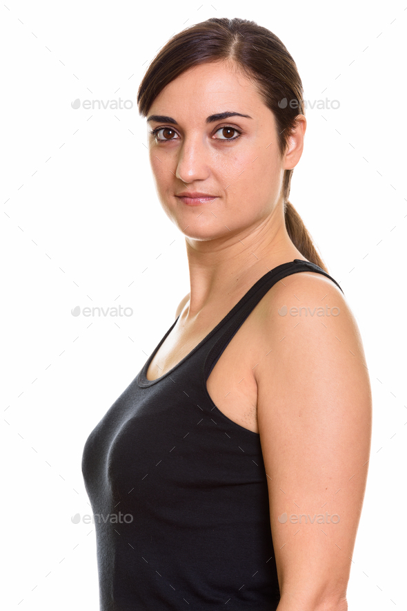 Closeup profile view of young beautiful woman looking at camera - Stock Photo - Images