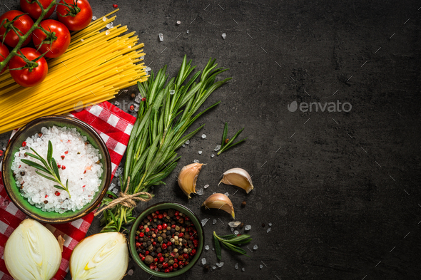 Food cooking background on black kitchen table - Stock Photo - Images