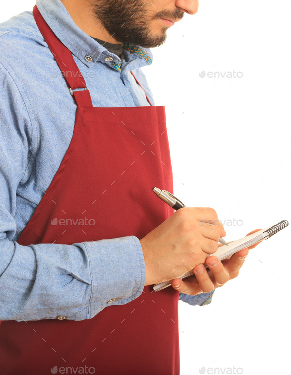Waiter with red apron writes an order standing on white background - Stock Photo - Images