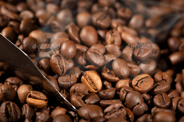 Roasted Coffee beans and scoop - Stock Photo - Images