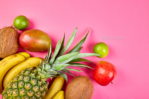 Flat lay of exotic fruits on pink background. - Stock Photo - Images