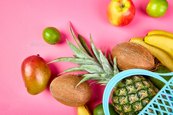 Grocery shopping bag with organic exotic fruits on pink background. - Stock Photo - Images