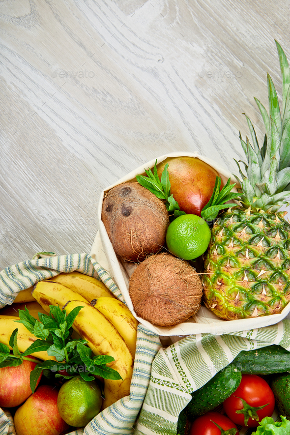 Fresh vegetables and fruits in eco cotton bags on table in the kitchen. - Stock Photo - Images