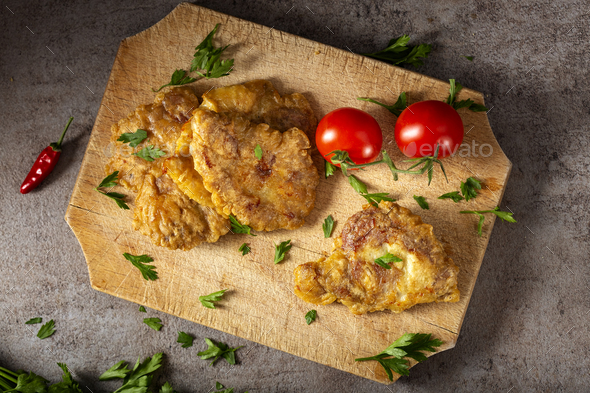 Schnitzel made from pork brain - Stock Photo - Images