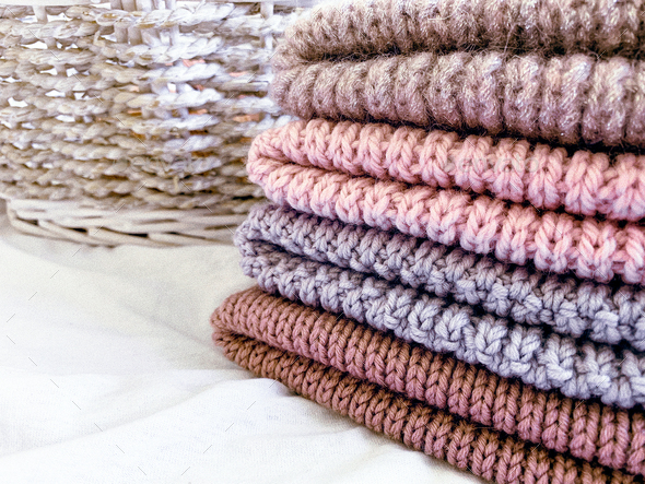 multicolored wool knitted hats in stack - Stock Photo - Images