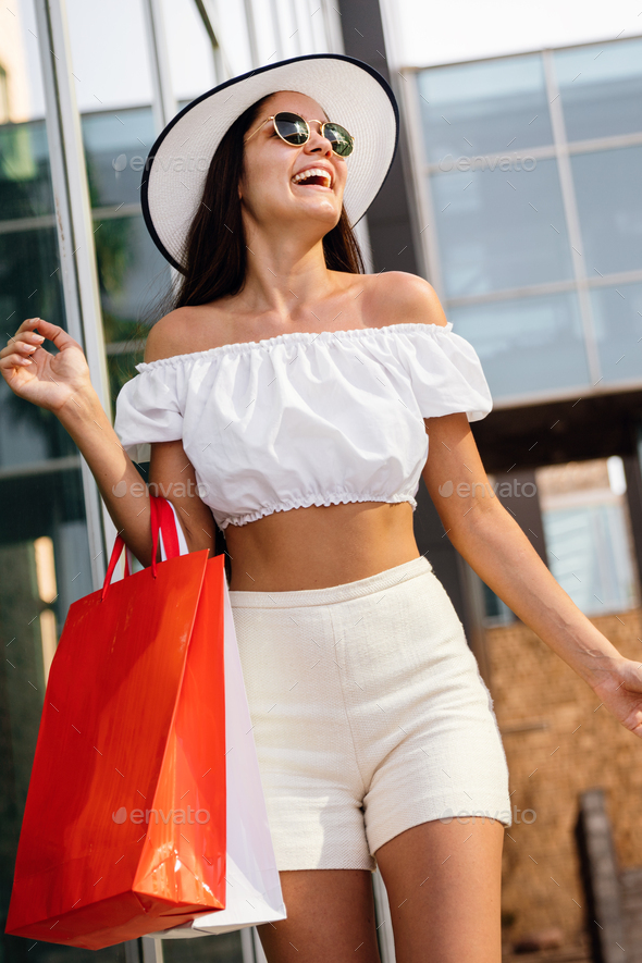 Sale, shopping, tourism and happy people concept. Beautiful woman with shopping bag - Stock Photo - Images