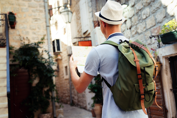 Happy young man smiling and traveling at summer vacation - Stock Photo - Images