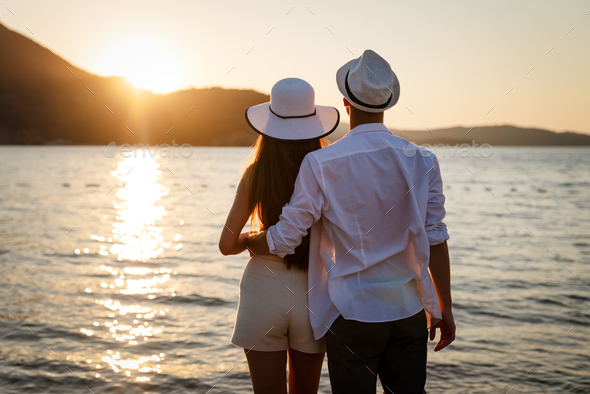Attractive young couple on the beach, enjoying summer vacation, travel - Stock Photo - Images