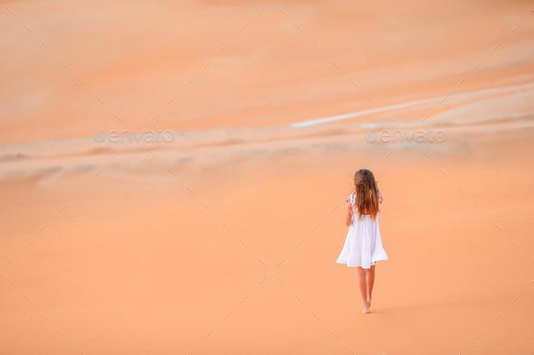 Girl among dunes in desert in United Arab Emirates - Stock Photo - Images