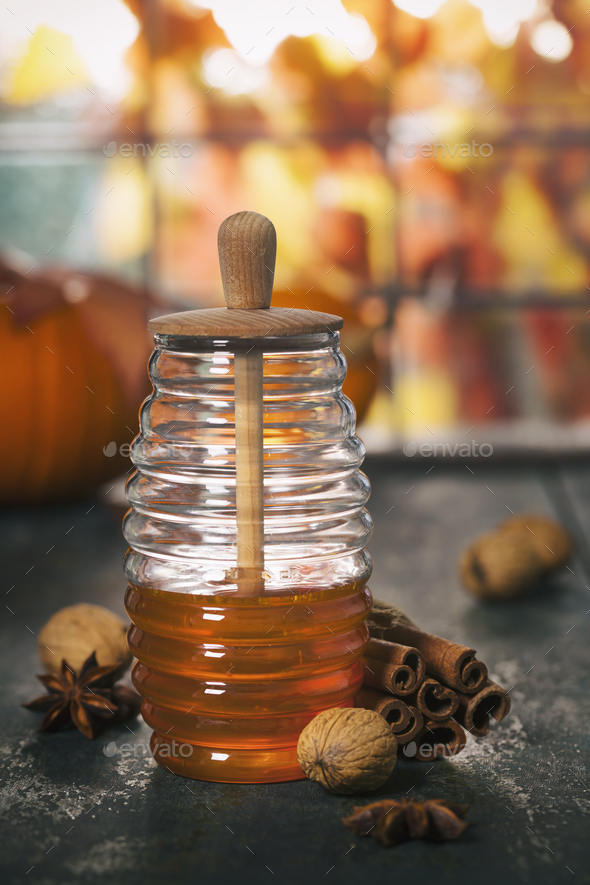Autumn composition. Jar of Honey, pumpkins and spices on wooden window sill. - Stock Photo - Images