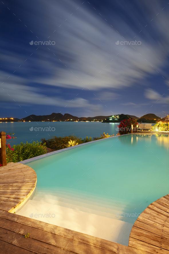 Pool And Caribbean Sea At Night, Antigua - Stock Photo - Images