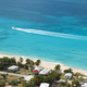 Motorboat Passing Beautiful Beach, Antigua - PhotoDune Item for Sale