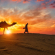 Indian cameleer camel driver with camel silhouettes in dunes on sunset. Jaisalmer, Rajasthan, India - PhotoDune Item for Sale