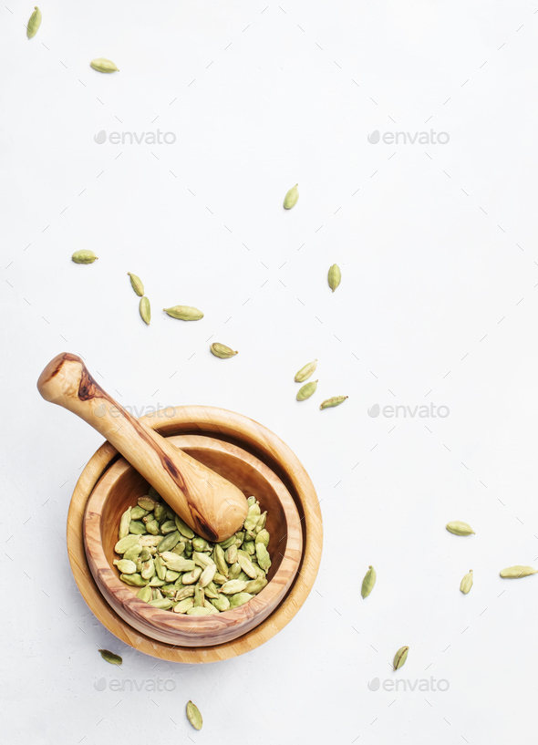Dry whole cardamom in wooden bowl - Stock Photo - Images